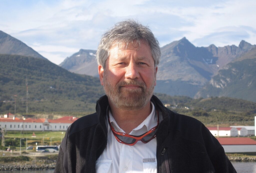 Paul Mayewski head shot in front of mountains