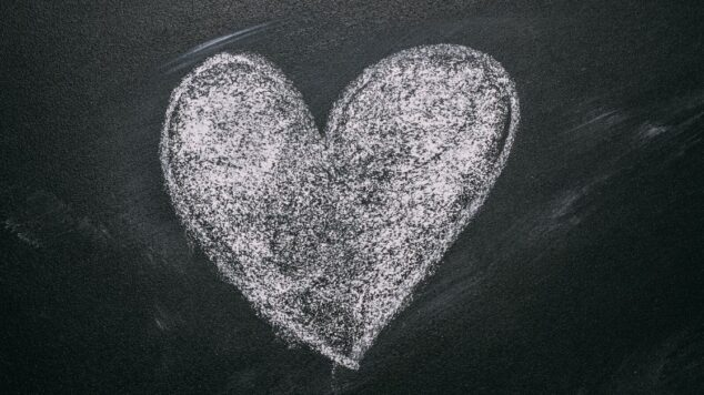 solid chalk heart on black chalkboard