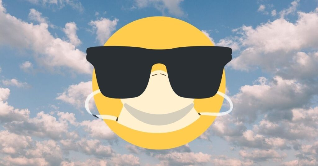Smily face in sunglasses wearing a mask in front of blue sky with cumulous clouds