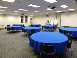 conference tables with blue table cloths and chairs