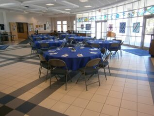 tables with blue table clothes in atrium
