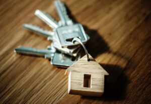 keychain with wooden house